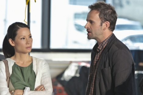 Jonny Lee Miller and Lucy Liu as Sherlock Holmes and Joan Watson with Jonny Lee Miller as Sherlock Holmes in CBS Elementary