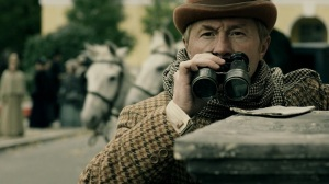 Andrei Panin Dr John Watson using binoculars in Russian Sherlock Holmes 2013 Episode 4 The Mistress of Lord Maulbrey